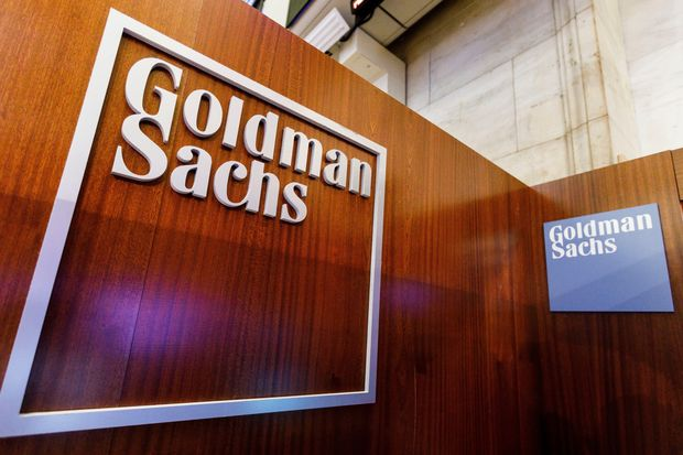 Goldman Sachs is cutting employee pay to invest in new